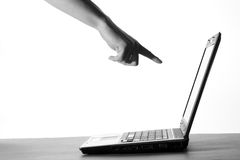 Hand pointing to the computer. Isolated over white background Royalty Free Stock Photos