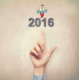 Hand pointing to 2016 concept. On light brown wall background Vector Illustration