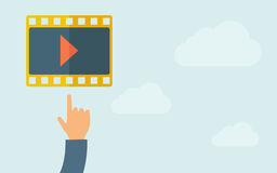 Hand pointing to a film icon. A hand pointing to film icon. A contemporary style with pastel palette, light blue cloudy sky background. Vector flat design Royalty Free Stock Photography