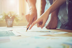 Hand pointing to a financial document on the desk. Between the agreed form of work to send customers. Royalty Free Stock Images