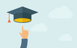 Hand pointing to graduation cap Royalty Free Stock Photo