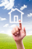 Hand pointing to house icon Royalty Free Stock Image
