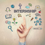 Hand pointing to Internship concept. On light brown wall background stock image