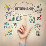 Hand pointing to Internship concept. On light brown wall background Royalty Free Stock Photo