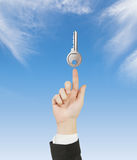 Hand pointing to key Stock Image