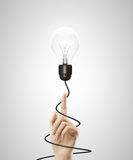 Hand pointing to lamp Stock Photos
