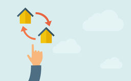 Hand pointing to little houses with arrow Stock Photos