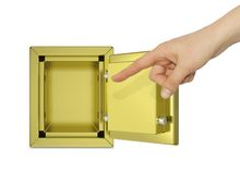 Hand pointing to the open gold safe. Isolated on white background. safety concept Royalty Free Stock Photography