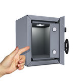 Hand pointing to the open safe Stock Image
