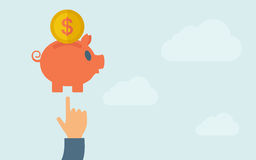 Hand pointing to piggy bank Royalty Free Stock Photo