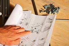 Hand Pointing To Plan Stock Image