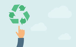 Hand pointing to recycling icon Stock Photos