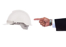 Hand pointing to safety helmet Stock Images