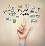 Hand pointing to Social Media concept Stock Photo