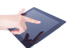 Hand pointing to a tablet Stock Image