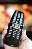 Hand pointing a tv remote control Stock Photo