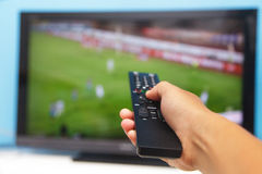 Hand pointing tv remote control Royalty Free Stock Photos