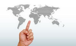 Hand pointing on world map Royalty Free Stock Photo