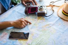 Hand pointing worldmap, planning for next trip.  stock photo