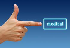 Hand points to Medical sign. Hand pointing to a Medical sign stock image