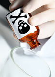 Hand with poison. Symbol of the crime Royalty Free Stock Image