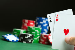 Hand with poker aces Stock Images