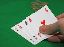 Hand with poker of aces on a table game Royalty Free Stock Images