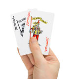Hand with poker cards Royalty Free Stock Image
