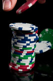 Hand with poker chips Stock Photography