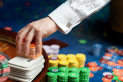 Hand of a poker dealer Royalty Free Stock Photos