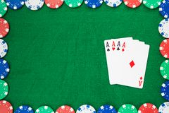Hand of Poker, four aces and chips on a felt green background. Top view and copy space stock images