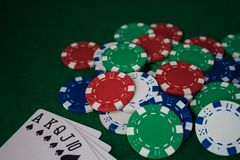 Hand of Poker, straight flush and chips on a felt green background. Top view and copy space royalty free stock photo