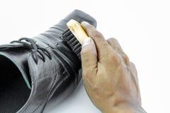 Hand polishing black men's shoes Royalty Free Stock Photography