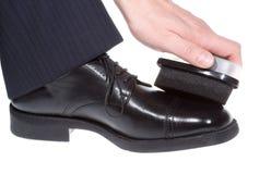 Hand polishing black shoe Royalty Free Stock Photo
