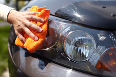 Hand polishing car. Royalty Free Stock Photography