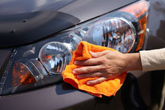 Hand polishing car. Royalty Free Stock Images