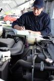 Hand polishing car. Royalty Free Stock Images
