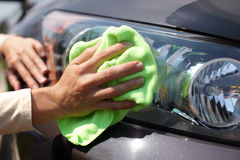 Hand polishing car. Stock Photo
