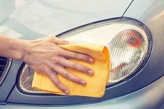 Hand polishing car to shine Royalty Free Stock Photography