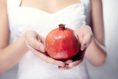 Hand with pomegranate Royalty Free Stock Images