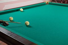 The hand with pool glove playing billiard. The hand with pool glove playing Russian billiard Royalty Free Stock Photos