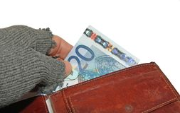 Hand of the poor man who steals euro money from wallet Royalty Free Stock Photography
