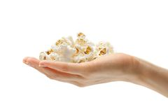 Hand with popcorn Stock Photos