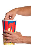 Hand with popcorn. Man hands with popcorn isolated on white background Royalty Free Stock Photography