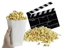 Hand with Popcorn, Movie clapperboard isolated on white royalty free stock photography