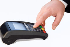 Hand and POS-terminal closeup. Hand enters the password in POS-terminal on  white background Stock Images