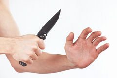 Hand position for the defense with a knife Stock Photos