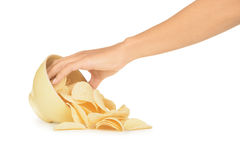 Hand with potato chips and bowl Stock Photos