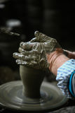 Hand of the potter Stock Images