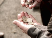 Hand with pound coins. Female hand holding English pound coins while waiting for bus Stock Images